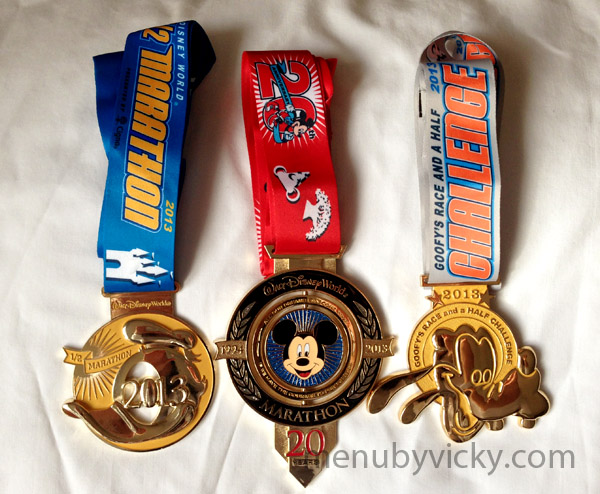 The medals for the half and full Disney marathons and Goofy.